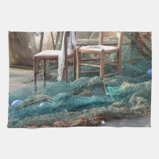 Weathered fishing nets on a harbor pier hand towel