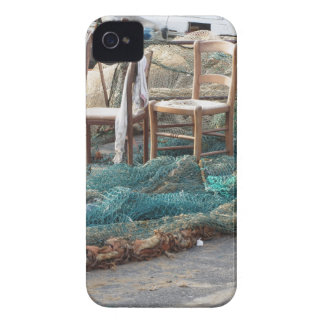 Weathered fishing nets on a harbor pier iPhone 4 case