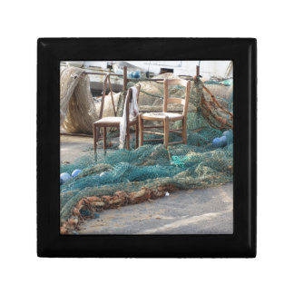 Weathered fishing nets on a harbor pier jewelry box