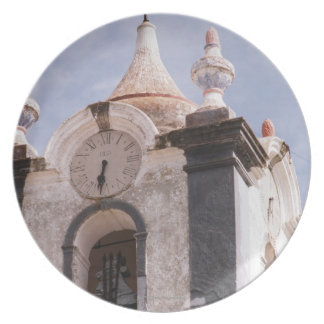 Weathered old-fashioned clock tower Portugal Plates
