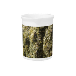 Weathered stone with lichen and moss background drink pitcher