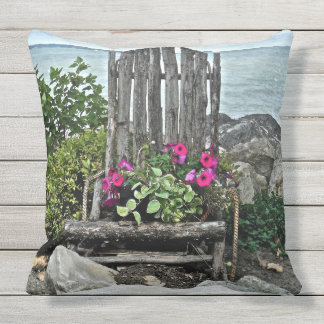 """""""WEATHERED WOODEN CHAIR WITH PETUNIAS ALONG LAKE"""" OUTDOOR PILLOW"""