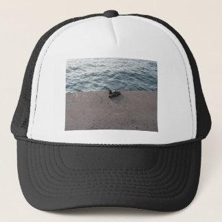 Weathered work glove forgotten on the harbor pier trucker hat