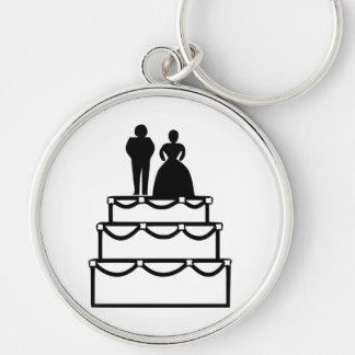 Wedding cake with bride and groom cartoon keychains