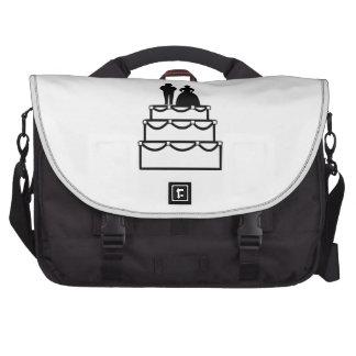 Wedding cake with bride and groom cartoon laptop bag