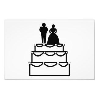Wedding cake with bride and groom cartoon art photo