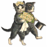 "Wedding Cats Cutout<br><div class=""desc"">Cute cat Bride and Groom Photo Sculpture. He looks elegant with his top hat and she is sweet in her rose accented bridal hair wreath and carries a matching rose bouquet. Makes a delightful ornament or cake topper.</div>"
