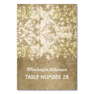 wedding escort cards string lights gold glitter table cards