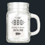 "Wedding Mason Jar | I Do BBQ<br><div class=""desc"">Casual BBQ / barbecue themed wedding mason jar design features stylish ""I Do BBQ"" wording and custom text in western style fonts,  along with a pig motif and star accents. Versatile product can be used for drinking glasses or wedding reception decor.</div>"