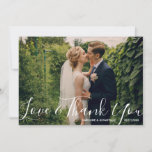 """Wedding Photo Love &amp; ThankYou Watercolor Flowers Thank You Card<br><div class=""""desc"""">Send your wedding thank yous out in style with this beautiful card featuring your photo and a beautiful white script font on the front. The backside features your custom thank you note surrounded by hand-painted watercolor flowers. Feel free to delete the typed text to make space for your handwritten note....</div>"""