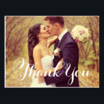 "Wedding Photo Thank You | White Elegant Script Postcard<br><div class=""desc"">Classic wedding thank you post card template features a photo on the front and back, &quot;Thank You&quot; in an elegant white script font, and custom text thank you message that can be personalized. White background on the back of the card can be customized to another color via Customize it /...</div>"