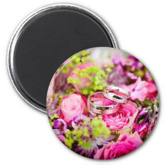 Wedding rings and pink roses composition design 2 inch round magnet