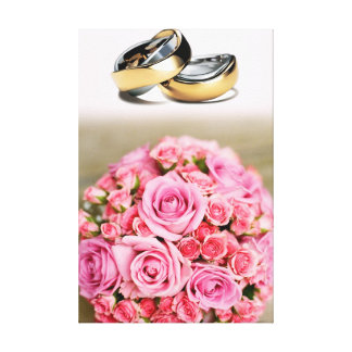 Wedding rings and pink roses composition design canvas print