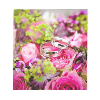Wedding rings and pink roses composition design notepads