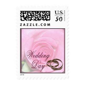 Wedding rings and rose postage