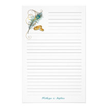 Wedding Rings and Teal Peacock Feather Lined Stationery