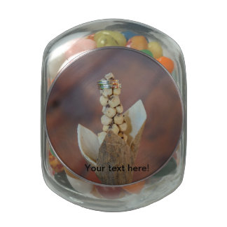 Wedding rings on a plant jelly belly candy jars