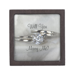 Wedding Rings on Gray Marry Me Gift Box