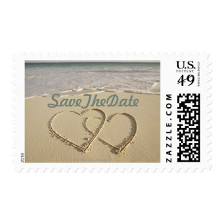 Wedding Stamps with Hearts Drawn on the Beach