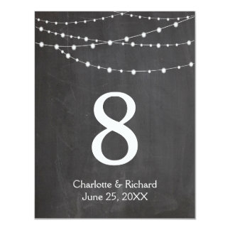 Wedding table numbers string lights and chalkboard card
