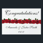 "Wedding Yard Sign<br><div class=""desc"">Yard sign perfect for your wedding reception celebration, shown in white with a red roses accent strip. Customize this item and change the names and date to yours.</div>"