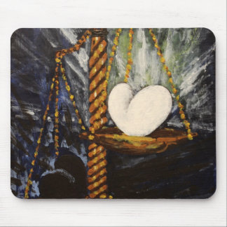 Weight of a heavy and light heart mouse pad