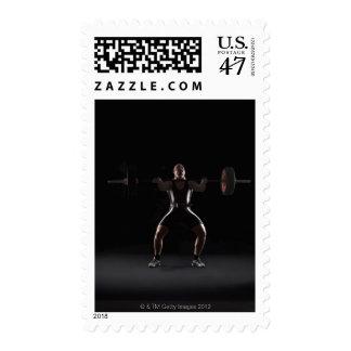 Weightlifter jerking weight postage stamp