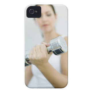 Weightlifting. Woman lifting dumbbells. This iPhone 4 Case-Mate Case
