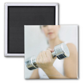 Weightlifting. Woman lifting dumbbells. This Magnet