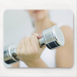 Weightlifting. Woman lifting dumbbells. This Mouse Pads