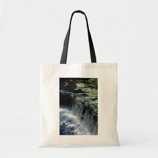 Weir on river tote bags