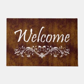 Welcome leather look floral swirl doormat