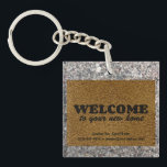 "Welcome  Mat Keychain<br><div class=""desc"">Realtors, this is a great way to welcome a client to their new home! Or friends and family, celebrate your loved ones newest purchase. Either way, this is a fun welcome mat design on a sidewalk texture background and welcomes people home. Real Estate agents can customize this with their contact...</div>"