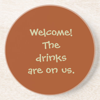 """Welcome! The drinks are on us."" Coaster"