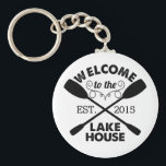 "Welcome to the Lake House Keychain<br><div class=""desc"">Start your lake vacation off right with this rustic-chic keychain. Design features &quot;Welcome to the Lake House&quot; in sandblasted black text with a rope illustration and two crossed canoe paddles. Customize with the year you started living life on the lake. Great hostess gift or housewarming present!</div>"