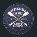 "Welcome to the Lake House | Rustic Canoe Paddles Dartboard With Darts<br><div class=""desc"">Spend your leisurely lakeside hours playing darts with this fun,  unique dartboard. Design features a midnight blue background with &quot;Welcome to the Lake House&quot; in rustic block text and two crossed canoe paddles. Customize with the year established for an awesome housewarming present or gift for your weekend hosts!</div>"
