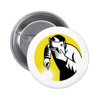 Welder at work welding set inside circle pinback button