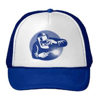 Welder at work welding set inside circle trucker hat