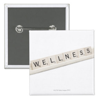 Wellness Spelled On A Word Board Game. 2 Inch Square Button