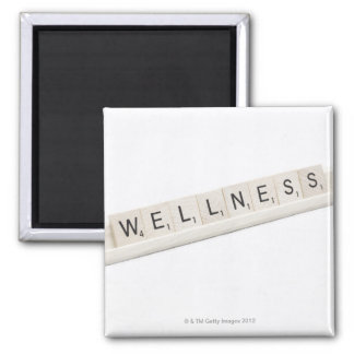 Wellness Spelled On A Word Board Game. 2 Inch Square Magnet