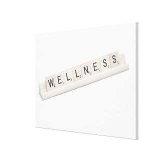 Wellness Spelled On A Word Board Game. Canvas Print