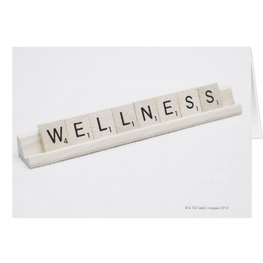 Wellness Spelled On A Word Board Game. Card
