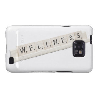 Wellness Spelled On A Word Board Game. Samsung Galaxy S2 Covers