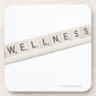 Wellness Spelled On A Word Board Game. Drink Coaster