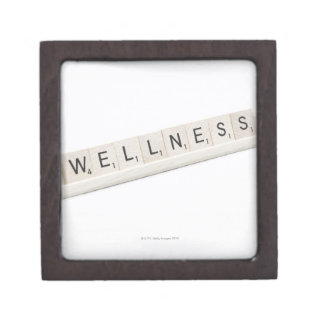 Wellness Spelled On A Word Board Game. Gift Box