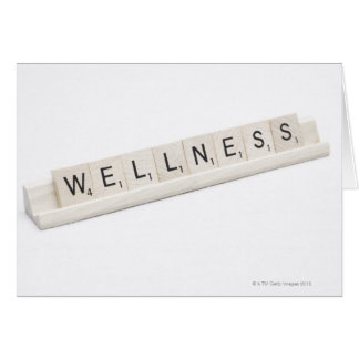 Wellness Spelled On A Word Board Game. Greeting Card