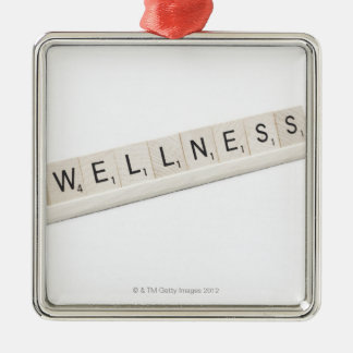 Wellness Spelled On A Word Board Game. Metal Ornament