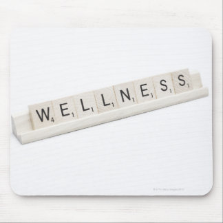 Wellness Spelled On A Word Board Game. Mouse Pad