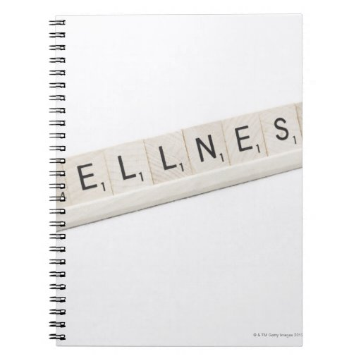 Wellness Spelled On A Word Board Game. Notebook
