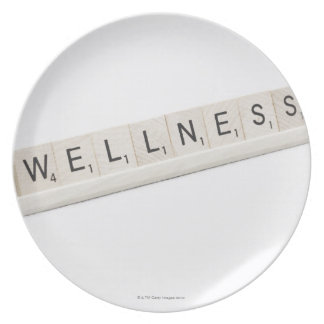 Wellness Spelled On A Word Board Game. Plate